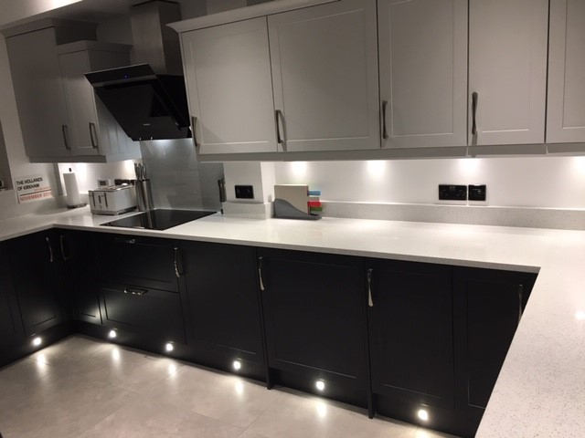 fitted kitchen in midnight blue and grey